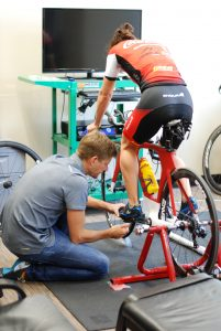 Lawrence performing a bike fit consultation with professional triathlete Rachel Joyce in May. Rachel came for ART with Lawrence after a serious foot injury; just last week she placed second at IRONMAN World Championship.